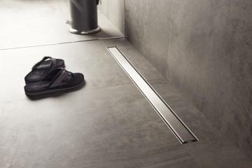 Flattest linear shower drain