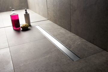 Linear shower drain with TAF system