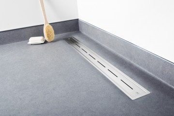 Linear shower drain for vinyl flooring