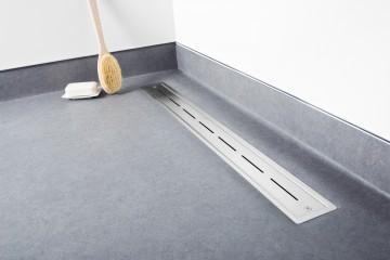Linear shower drain for vinyl flooring