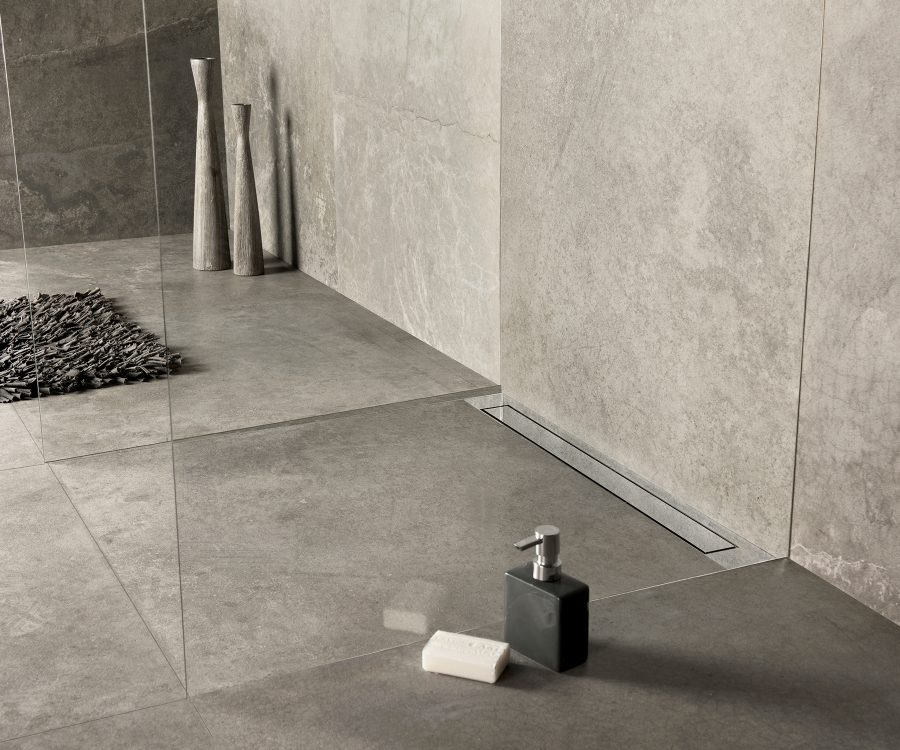 linear shower drain against the wall