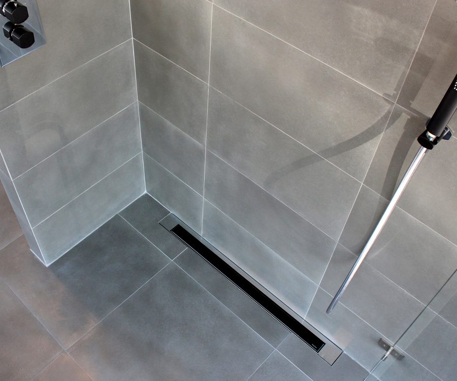 black glass grate wall installation shower drain
